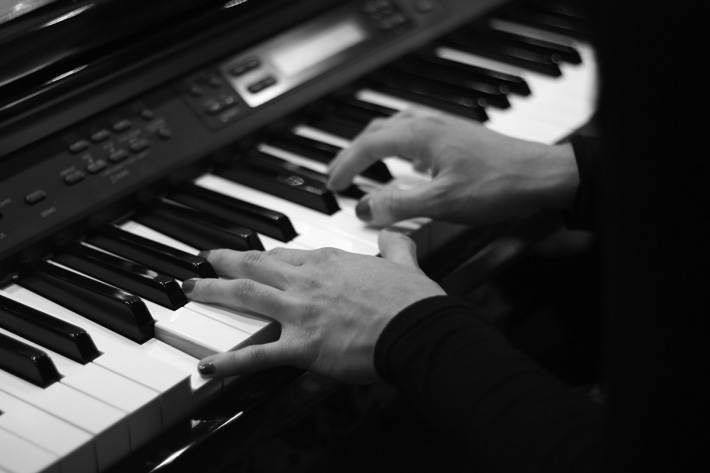 fingers on piano keys